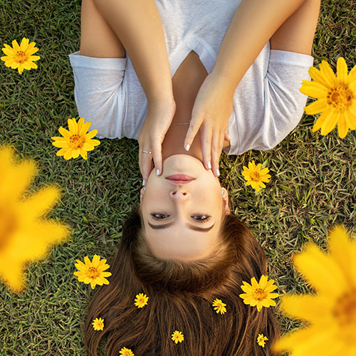 Girl laying in flowers
