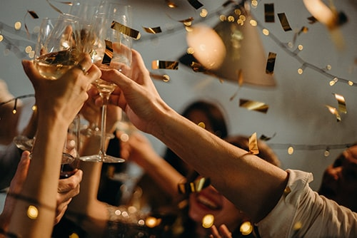 Toasting wine glasses at a holiday party