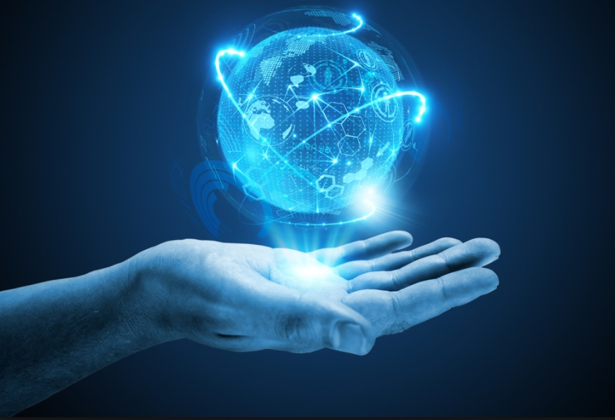 Digital hand holds the world in the palm of it's blue virtual hand.