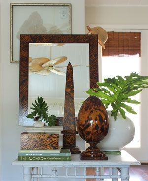 humble console with faux tortoise obelisk