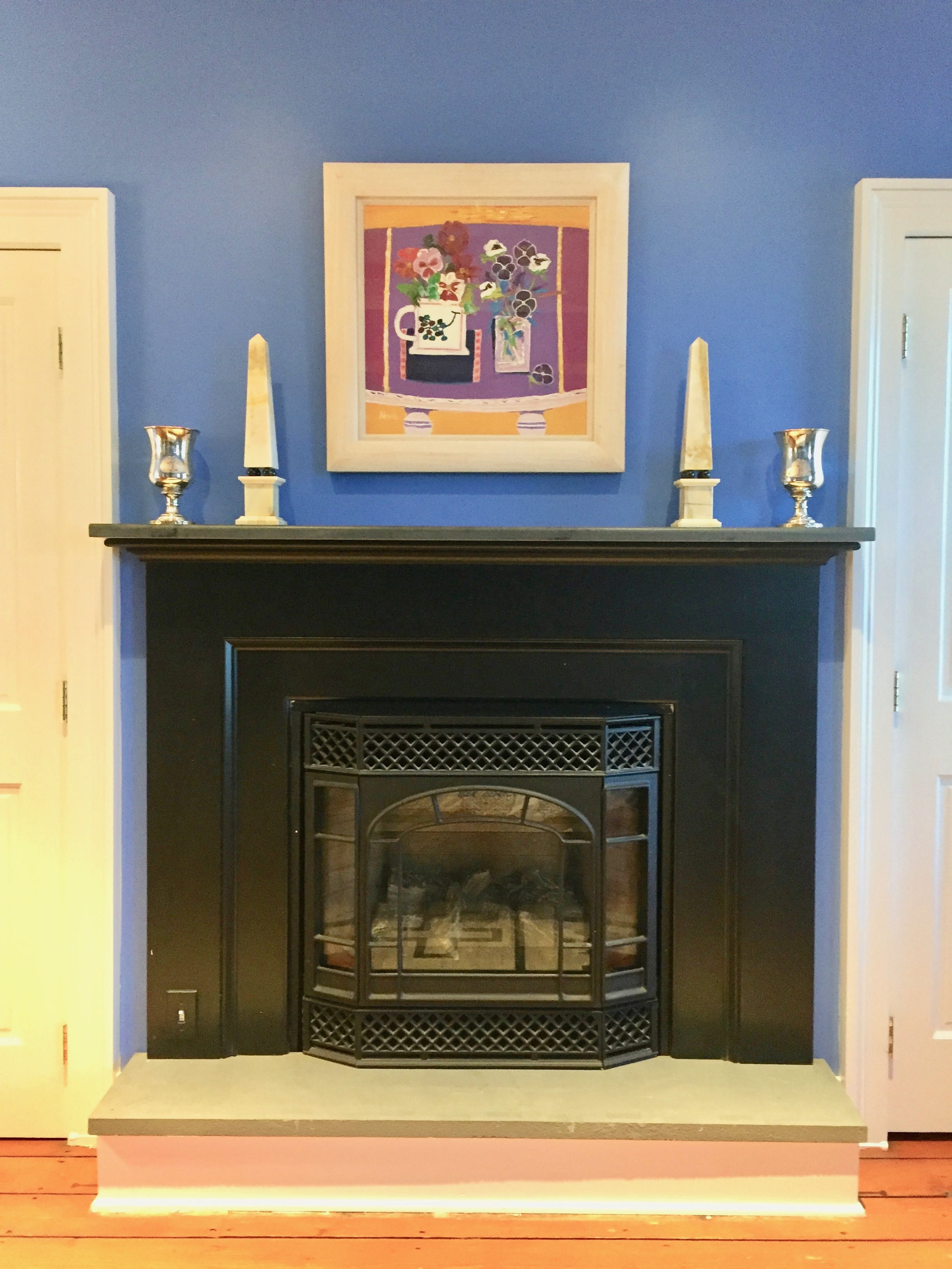 mantel decorated with obelisks