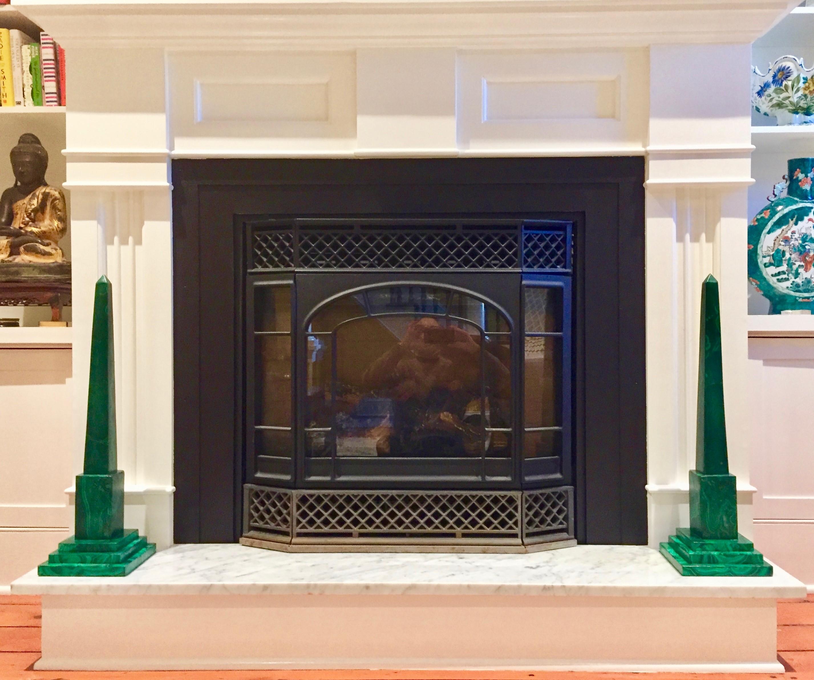 Only Obelisks fireplace with dramatic malachite obelisks