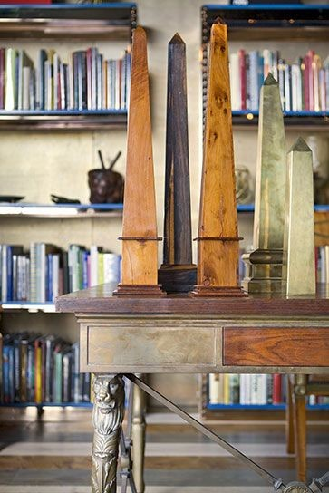 Wood and brass library obelisks