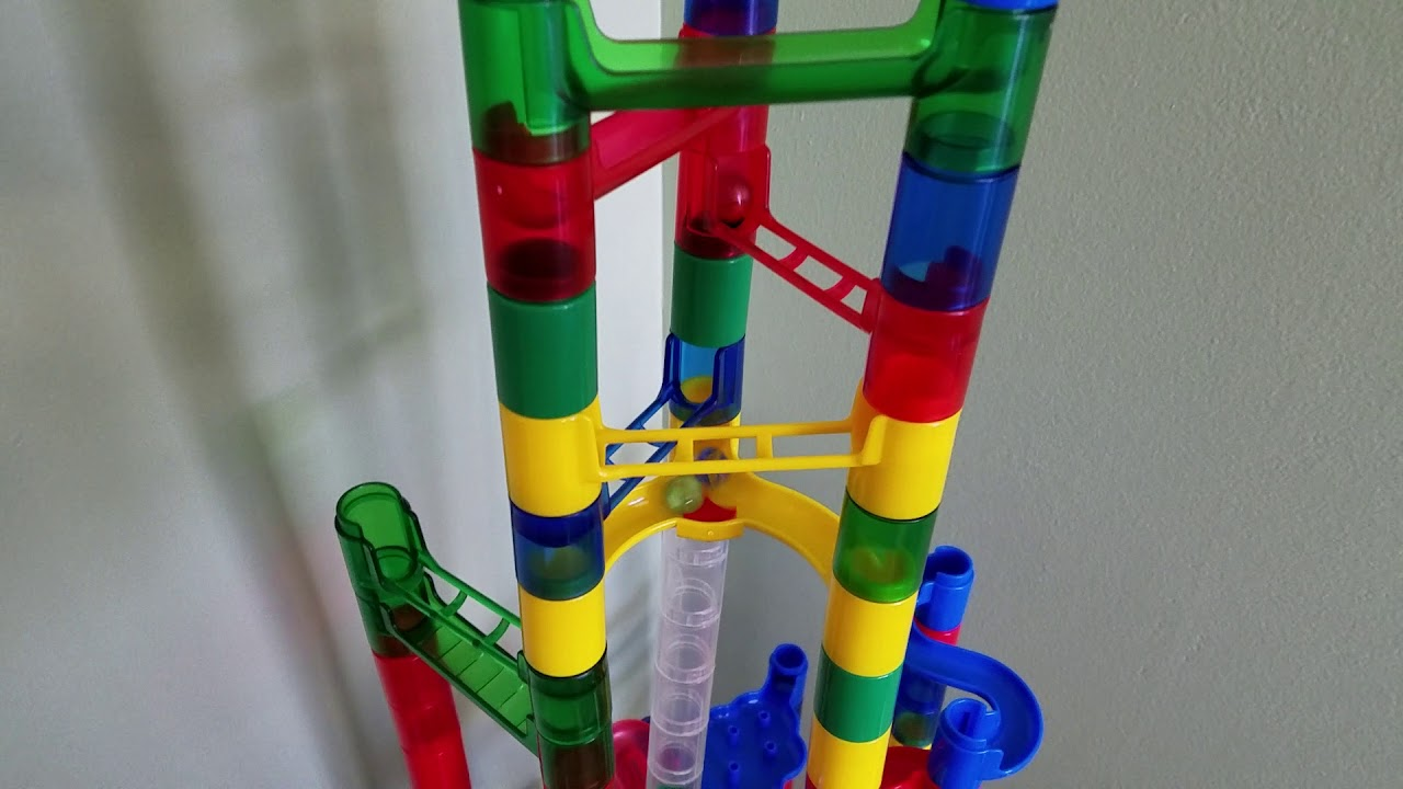 1000 MARBLES DESTROYING A MARBLE RUN!?
