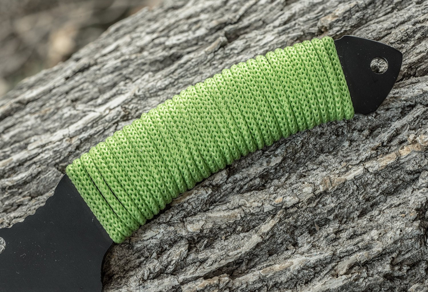 green hatchet axe with full tang and paracord handle