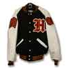 This is a simple yet beautiful letter jacket with black wool body and white leather sleeves. An old-english letter is on the front along with an embroidered name.  The sleeves of the letterman jacket have a class of chenille patch and a chenille chevron patch.