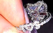 The back of the ring bedecked in diamonds