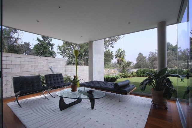 the noguchi table is a good option for semioutdoor places like terraces and verandas in this roofed terrace a living room effect takes center stage with