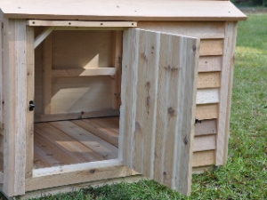 NEW Clean-out Whelping side access door. (3/5\  thick tongue-n-groove cedar) & Goliath Dog House